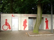 "Image showing public toilets with signs for ""men's"", ""women's"" & ""wheelchair access""."